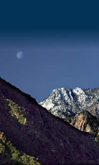 Daytime moon over the mountains